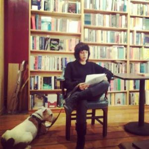 Maggie reading at Inquiring Minds bookstore last week, with her dog Mickey